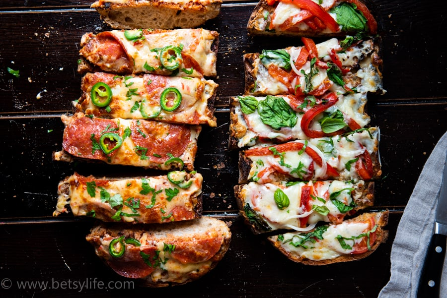 close up of two french bread pizzas sliced into strips