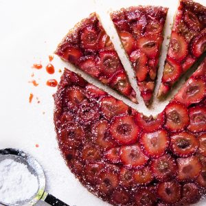 strawberry upside down cake cut into triangle slices
