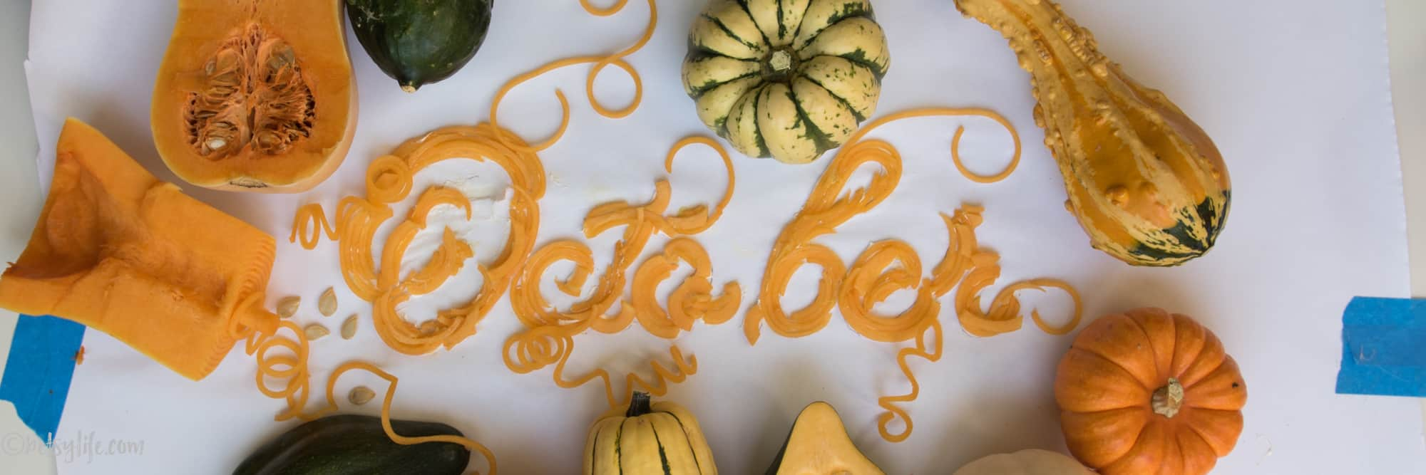 creative food styling with squash spelling out October