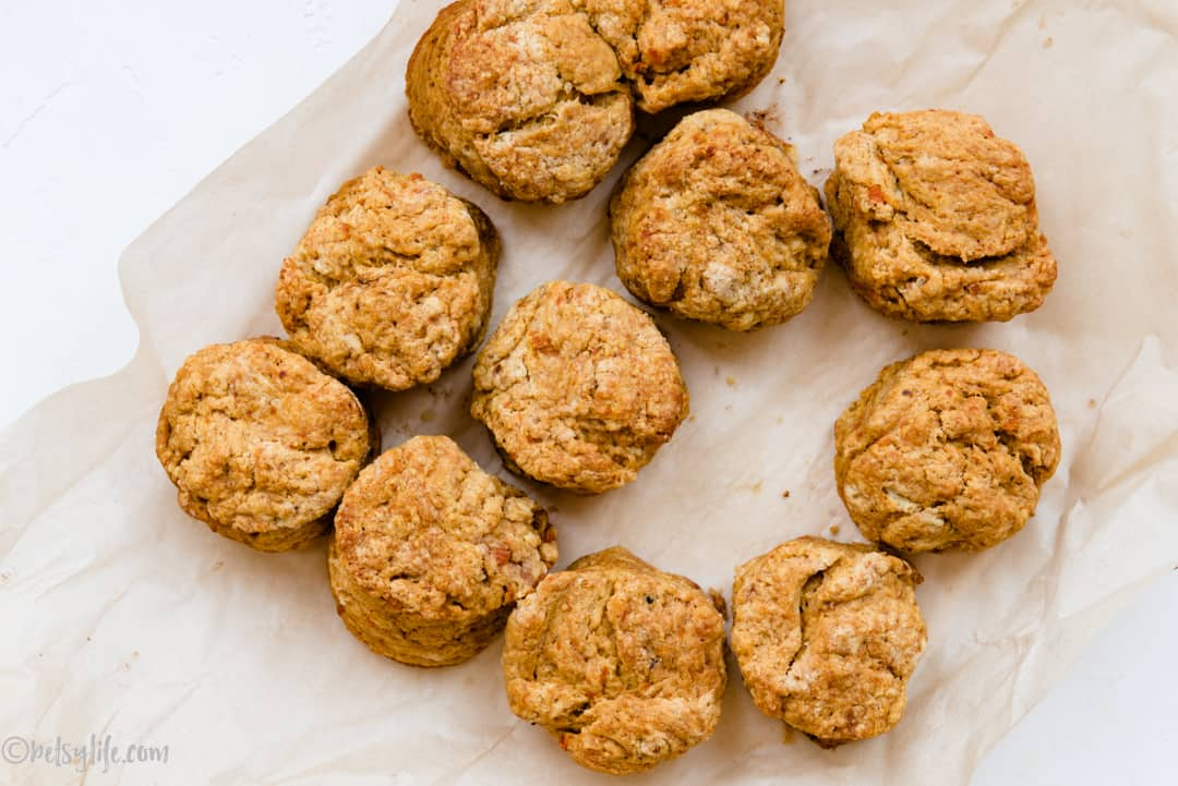 overhead shot of sweet potato biscuits on parchment paper