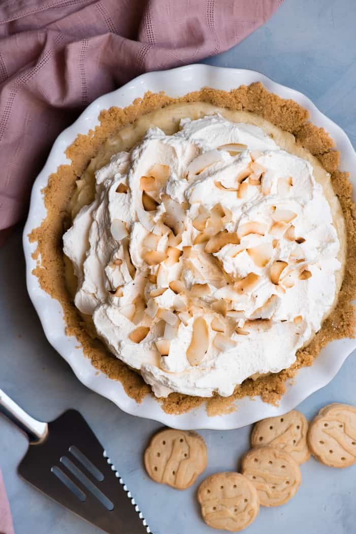 Coconut cream pie with a short bread crust next to girl scout cookies